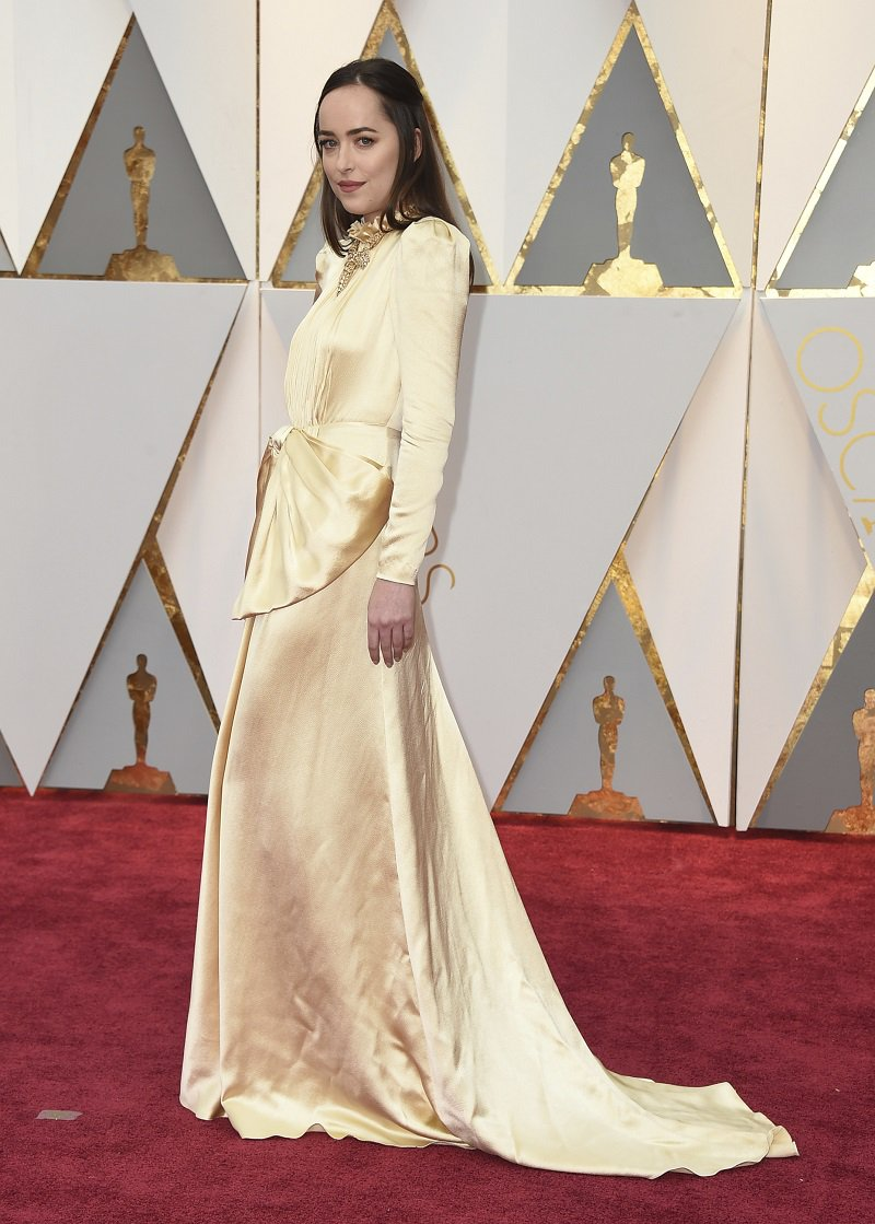 Dakota Johnson arrives at the Oscars on Sunday, Feb. 26, 2017, at the Dolby Theatre in Los Angeles. (Photo by Jordan Strauss/Invision/AP)